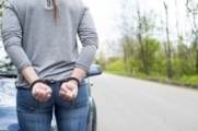Woman handcuffed outside of the car - Felony DUI lawyer in Atlanta
